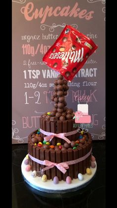 Two tier Gravity maltesers cake, m&m's , kit kats and mini eggs.