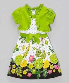 With a vibrant floral print dancing with polka dots across its twirlable silhouette, this fanciful frock will introduce a bright blossom of color to special occasions. A dainty ruffled shrug tops off the lovely look with ladylike charm for an ensemble that's garden-party perfect.