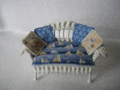 Quarter scale miniature wicker loveseat by CherylHubbardMinis on Etsy Beige Background, Rocking Chair, Blue Backgrounds, Cheryl, Seat Cushions, Shades Of Blue, Wicker, Love Seat, Hand Weaving