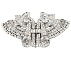 Art Deco Platinum & Diamond Clips / Pin | From a unique collection of vintage brooches at http://www.1stdibs.com/jewelry/brooches/brooches/