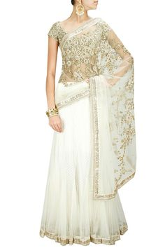 Sabyasachi gold and white half saree.