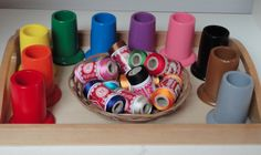 A great color matching lesson for toddlers that you can make at home using thread and any kind of painted matching cans.