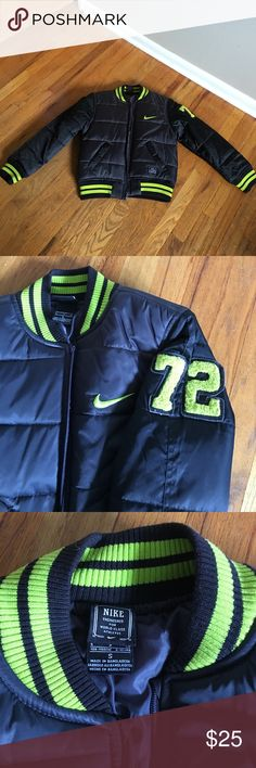 Nike boys sz S jacket NWOT Nikes boys jacket sz small, reminds me of a varsity baseball jacket/coat it's a heavier and loftier jacket. It's black with neon yellow green accents. Nice item, my son didn't care for the style. Fits probably a sz 6/8 Nike Jackets & Coats