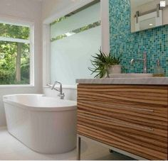 modern bath with zebrawood vanity and Bisazzo glass mosaic tile wall by Wrightworks, LLC