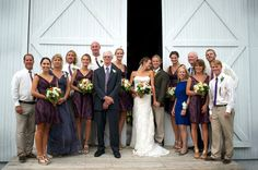 Casual Bridal Party pose in front of a white barn