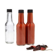 Make your own spicy hot sauce with this DIY kit, offering cayenne, ancho, curry, and chili spice packs.