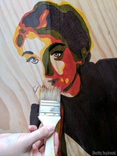 Use stain on a wooden canvas to create a posturized portrait wall art! {Reality Daydream}