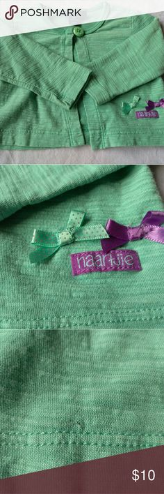Naartjie Baby Top Naartjie baby size 3-6 month sweater. Has two little bows on the bottom left.  Has a tiny pin hole that is barely visible on bottom right just above the seam (see third pic). Naartjie Shirts & Tops Sweaters