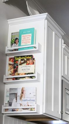 Cookbook racks on the side of the kitchen cabinet to save space. (image and tutorial: the2seasons)