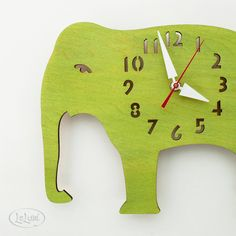 I just want to hug this fellow!!  The Big Lime Green Elephant designer wall mounted clock by LeLuni