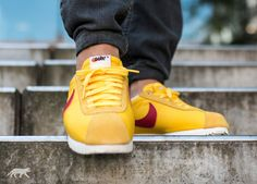 nike cortez yellow red