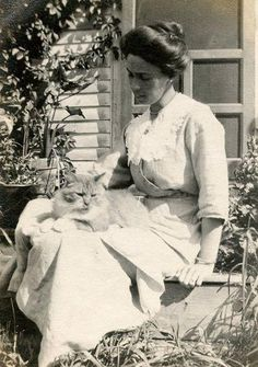 "sitting on the kitchen porch with the kitty - a classic scene. (Russian caption says ""Olga Peskina"")"