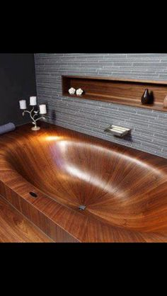 A hand carved wood bath tub