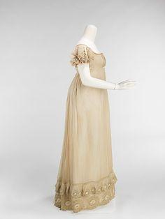 Dress.  Date: ca. 1810. Culture: American. Medium: cotton, silk. Dimensions: Length at CB: 56 in. (142.2 cm).