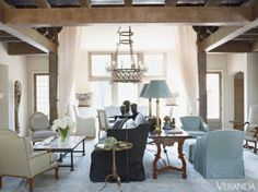 Designer Susan Ferrier made the double-height living room of this Mountain Brook, Alabama, home feel more intimate by creating a variety of seating arrangements.