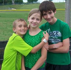 Zach, Jackie, and Jacob at a track meet