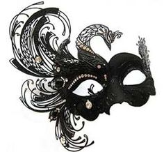 A striking Venetian pheonix mask for man or woman with lasercut metal and Austrian crystals.