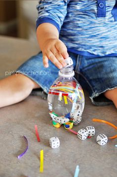 How easy! Fine motor skills, sensory and loads of fun! Water, a few pom poms, glitter — hours of fun!