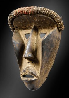 Africa | Mask from the Dan/Kran people of Liberia | Wood, natural fiber, seeds | ca. prior to 1960