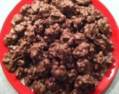 CROCKPOT CHRISTMAS CRACK 16 oz unsalted peanuts, 16 oz. salted peanuts, 12 oz semi-sweet chocolate chips, 12 oz milk chocolate chips, 20 oz peanut butter chips, 2 lb white almond bark or vanilla candy coating:  Layer all ingredients in a large crockpot (starting with peanuts). Cook on low, covered & leave set for 2 hours. Then, remove lid and stir to combine. Cover and simmer for another 30 minutes. Stir again and then spoon mixture on to wax paper. Allow to harden for at least 1 hour.