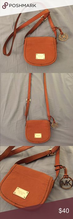 Michael Kors Cross Body Chestnut brown Michael Kors Cross Body bag. Adjustable belt buckle strap to alter size. MK emblem attached. Minor stains on inside flap (see pictures) 2 compartments on the inside and compartment on the back. 7 inches in width 6 inches in height. Strap is about 25 inches. Great condition!!! Michael Kors Bags Crossbody Bags