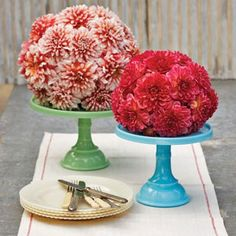 Cake stands get a new purpose, holding brightly colored floral domes. To make this centerpiece, cut the bottom of a foam ball, so it sits flat. Then soak it in water for 30 minutes before inserting the flowers.