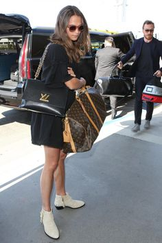 Alicia Vikander wearing Louis Vuitton Weekend Bag, Celine Baby Audrey Sunglasses in Antique Rose and Louis Vuitton Twist Gm Bag