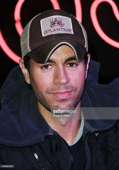 Enrique Iglesias meets fans and signs copies of his new album 'Sex + Love' at HMV, Oxford Street on March 27, 2014 in London, England.