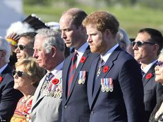 The royals took a moment to reflect during the service, which marked the 100th anniversary...
