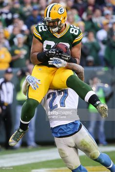 Richard Rodgers #82 of the Green Bay Packers catches a 4 yard pass against Glover Quin #27 of the Detroit Lions for a touchdown in the fourth quarter at Lambeau Field on November 15, 2015 in Green Bay, Wisconsin.