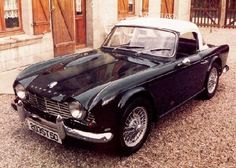 Triumph TR4 Roadster - like the black '65 I had except mine had a black top.  I miss it.
