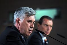 Carlo Ancelotti (L) attends a press conference with former Real Madrid player Emilio Butragueno during his presentation as Real Madrid's new head coach at Estadio Bernabeu  on June 26, 2013 in Madrid, Spain