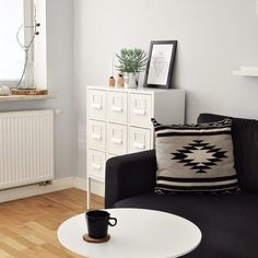 Ikea 'Sprutt' cabinet and 'Karlstad' sofa