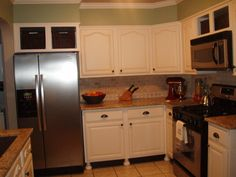 """$5000 Kitchen Makeover, """"I painted the kickspace black and added legs to give the cabinets more of a custom freestanding furniture look."""""""