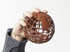 Gridded Globe by MakerBot.  While not the exactly the Unisphere - this will look great on your desk.