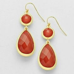 """Ruby red tear drop earrings NWT Gold tone dangle earrings dazzled with ruby red stones. Pierced hook style. 2"""" long. Lightweight and fabulous!! Brand new with tag. Jewelry Earrings"""