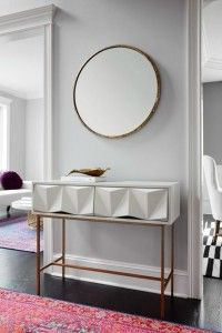 In this article, we cover a series of gold and white console table designs, in several shapes, forms and styles. Let yourself get inspired by the selection.