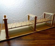 cardboard and string suspension bridge model