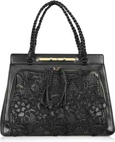 valentino leather and lace handbag... I would give someone my right leg for this. maybe not but damn aint nothing wrong with window shoppin