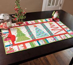 Merry Little Christmas Table Runner Kit @ Connecting Threads: Appliqued trees.  36 x 20 inches. (Currently unable to find this pattern on the Site. I think I could re-create something like it. Maybe it will be back next Christmas????)