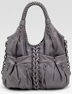 Dear Stitch Fix Stylist, <3 almost everything --  the detail all over the purse, the pockets, the cross hatching, the color.  Not sure about the handle???  Might be a bit short???  ~~~  grey one