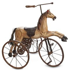 """Mid-19th Century French Wooden Horse Tricycle with Superb Carving 34"""" (86 cm.) l. 36h. The deeply-carved wooden horse with sculpted detail o..."""