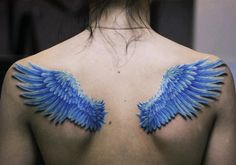 The tattoo artist has given these wings a shadow, to create the illusion that the wings are above the skin. The color blue is a symbol of healing, forgiveness, vision and truth. Combined with the symbolism of wings, this tattoo could mean that this person finds freedom in truth or aims for good health. Combining two symbols can often create a variety of different meanings for a tattoo.