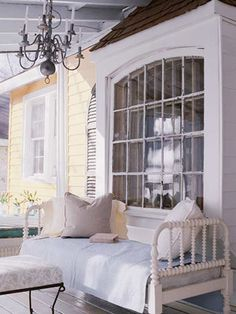 Painted daybed on porch in little cottage I renovated, featured in Better Homes & Gardens Quick & Easy Decorating.  Photographed by Michael Partenio.