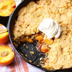 Skillet Sugar Cookie Peach Cobbler-This yummy peach cobbler recipe is extra sweet, made with a sugar cookie crumbled topping and baked right in a skillet.  It's simple, yet pretty enough to serve to guests. This fruit dessert makes a great summer time gathering sweet treat for guests of all ages...especially a barbecue. Add a scoop of ice cream.