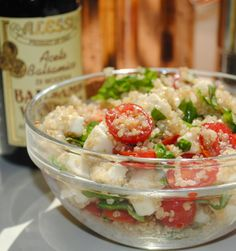 -1/2C quinoa -8 oz fresh mozerella -1 carton grape tomatoes, halved -fresh basil -2T olive oil -salt & pepper