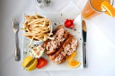 On the OCEANS 5 SEAFOOD MARKET AND EATERY lunch menu, New England lobster rolls. In Shoreham.