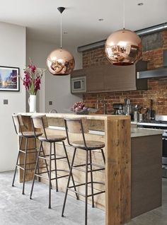 Smart Industrial-style Breakfast Bar with Copper Touches | Visit www.vintageindustrialstyle.com for more inspiring images and decor inspirations