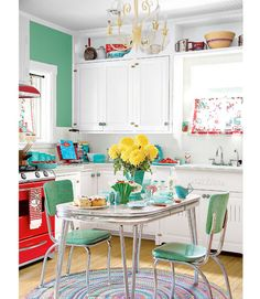 A Pinch of Turquoise This homeowner took cues from old '50s wares such as Pyrex bowls and printed tablecloths. Read more: Kitchen Designs - Pictures of Kitchen Designs and Decorating Ideas - Country Living