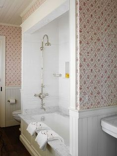 Nancy Boszhardt Inc.  This is the exact layout of one of our bathrooms.  Love the tub - don't like that wallpaper though!